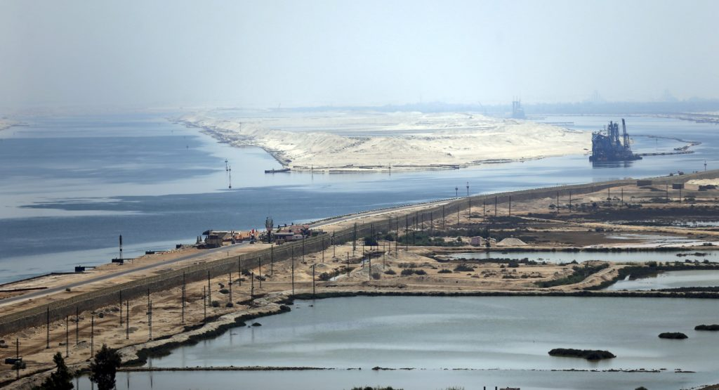 "A general view of the Suez Canal from Al Salam ""Peace"" bridge on the Ismalia desert road before the opening ceremony of the New Suez Canal, in Egypt, August 6, 2015. Egypt will open an expansion to the Suez Canal to great fanfare on Thursday, the centrepiece of President Abdel Fattah al-Sisi's plans to revitalise the country's economy after years of damaging political turmoil. REUTERS/Amr Abdallah Dalsh"
